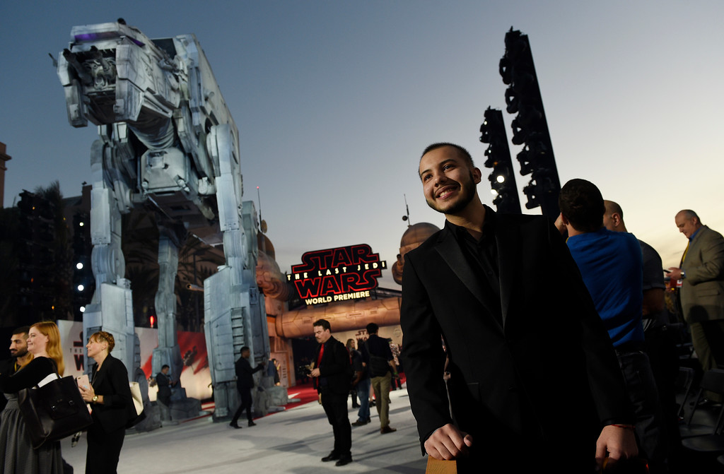 """. In this Dec. 9, 2017 photo, Chris Alegria, 18, of Pembroke Pines, Fla., enjoys the view from his spot on the carpet at the premiere of the film \""""Star Wars: The Last Jedi\"""" at the Shrine Auditorium in Los Angeles.  Alegria was one of seven teens with life-threatening medical conditions who were among the special guests at the premiere as part of the Make-A-Wish Foundation. (Photo by Chris Pizzello/Invision/AP)"""