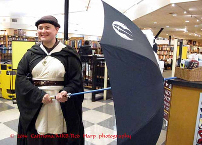 Examining the lightsaber umbrella combo.... brought by a fan.