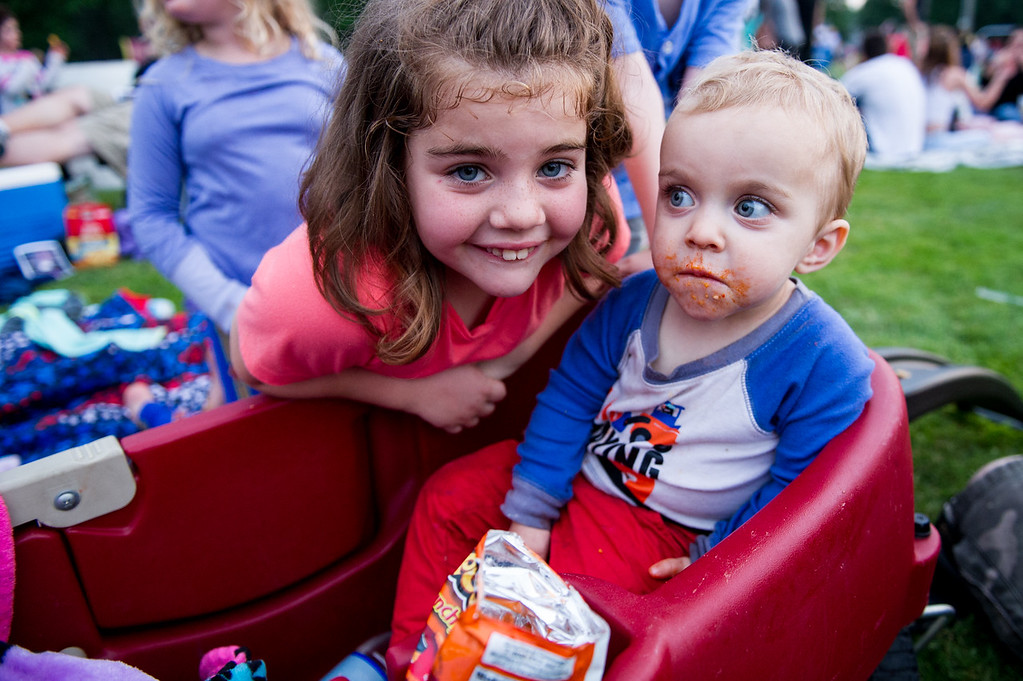 . Samantha-Ann Racine, 8 (left), and Scott Racine, 1 (right) of Fitchburg, hang alongside a wagon waiting for the fireworks at Starburst 2017 held on Saturday June 17, 2017 at Doyle Field in Leominster.  SENTINEL & ENTERPRISE/JEFF PORTER