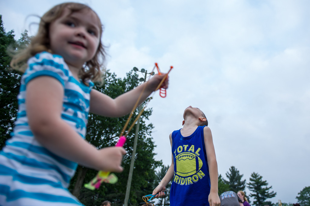 . Call Landry, 3, of Leominster (left) and Eli Rivera, 7, of Leominster, fling spinners high into the air at Starburst 2017 held on Saturday June 17, 2017 at Doyle Field in Leominster.  SENTINEL & ENTERPRISE/JEFF PORTER