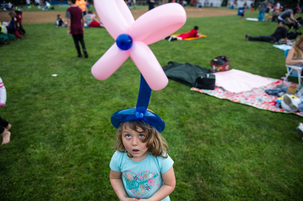 . Fiona Fafard, 4, looks up at her balloon hat at Starburst 2017 held on Saturday June 17, 2017 at Doyle Field in Leominster.  SENTINEL & ENTERPRISE/JEFF PORTER
