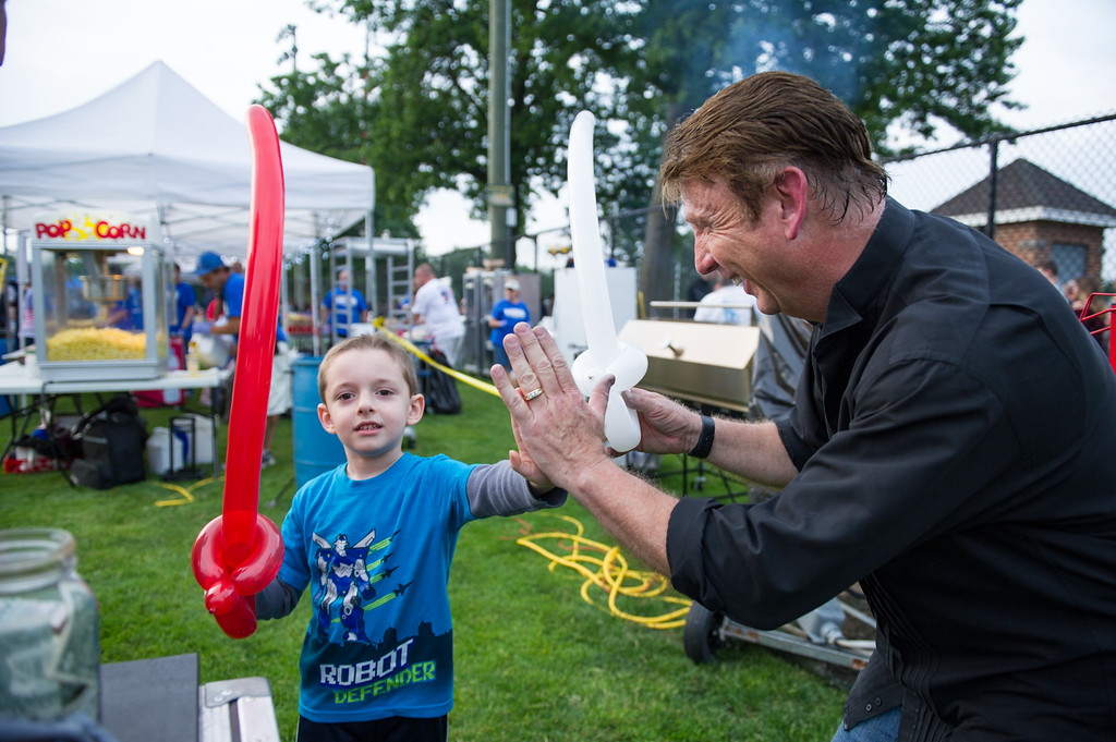 . Matthew Cooke, 5, of Leominster high fives magician Steve Charette at Starburst 2017 held on Saturday June 17, 2017 at Doyle Field in Leominster.  SENTINEL & ENTERPRISE/JEFF PORTER