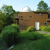 Starmere Observatory - 2009<br /> <br /> Originally this was an unfinished two story, two car garage (right half of structure).  The second floor was dormered to become the heated/cooled control room and the left half (which is unheated) of the structure, under the dome, was added.  The dome is a Home Dome brand dome (10' in diameter).  Decking around the dome allows for viewing the coming weather and sky at night.