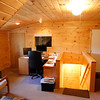 Control room w home made desk and window looking in to dome room