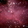 Detail - Pillars of Creation in the Eagle Nebula (Zoomed in center of other Eagle picture)<br /> <br /> These famous Pillars (seen with green hue with the famous Hubble picture) are approximately 3 light years high and 1/2 light year deep.  The dust that makes them up is only 4,000 particles per cubic centimeter whereas the air on earth at sea level has about 10 to the 19th power particles per cubic centimeter!  It is the depth of the dust areas that gives these Pillars their shape and apparent volume.  We on earth are not capable of producing a vacuum as perfect as only 4,000 particles per cubic centimeter.