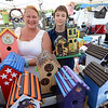 Amy Minor and her son Leo, 15, of Kimball, Michigan, show of a couple of  birdhouses and lighthouses from their business, Beau & Amy's Custom Birdhouses, which they are selling at the Stars and Stripes festival.  Ray Skowronek--The Macomb Daily