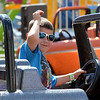 6 year old Ian Bittner of Sterling Heights, waves to his dad as he has some fun on the Monster Truck ride at Stars and Stripes festival.  Ray Skowronek--The Macomb Daily