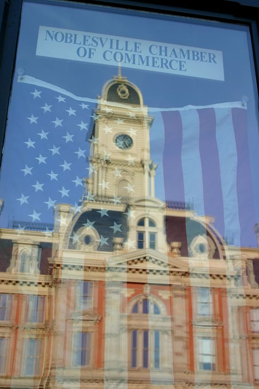 American Flag with reflection of the Hamilton County Courthouse, Noblesville, Indiana.