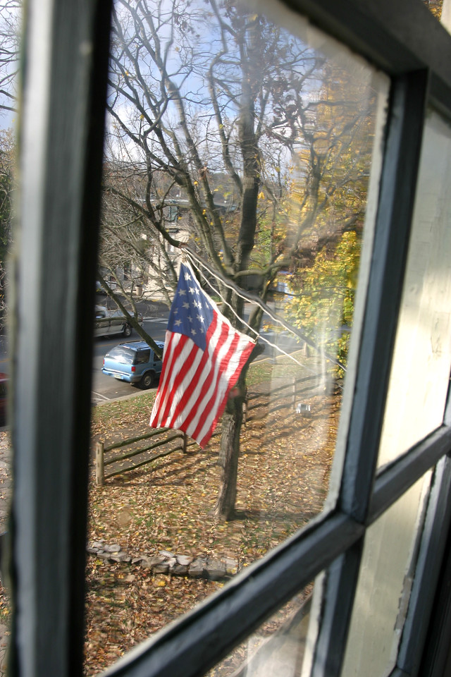 19-star American Flag.  Through the 2nd floor window of Indiana's first State Capitol building in Corydon, Indiana.