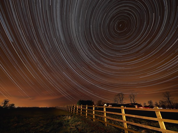 Star Trail spinning over a rural cottage in South Leicestershire for a farmer client. 7 hours of spinning stars showing Earth rotation.