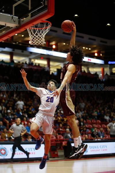 Santa Fe Indian's James Bridges, number 21, dunks over Hot Springs' Nathan Salcido, number 20, during the first quarter of the Santa Fe Indian School vs Hot Springs High School state final game at The Pit on Saturday, March 16, 2019. Luis Sánchez Saturno/The New Mexican