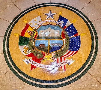 """""""Remember the Alamo"""" terrazzo mosaic of reverse seal of Texas on the floor of the capitol extension, showing the six flags of Texas"""