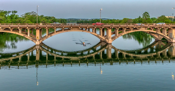 The Lamar Bridge is a historic arch bridge carrying Texas State Highway Loop 343 (Lamar Boulevard) over Lady Bird Lake in downtown Austin, Texas. The bridge features six open-spandrel concrete arches spanning 659 feet and carries tens of thousands of vehicles daily across the lake.