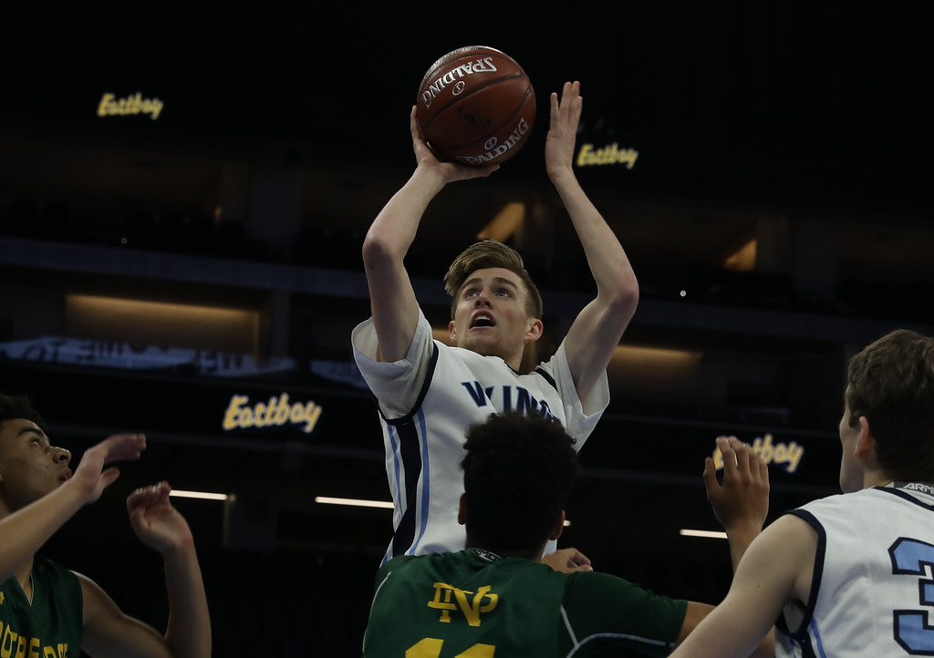 . Pleasant Valley High\'s Jake Rick goes up for a shot against Notre Dame High\'s Pierce Sterling (11) and Anton Mozga (1) during the state championship game at Golden 1 Center, March 24, 2018, in Sacramento, California. (Carin Dorghalli -- Enterprise-Record)
