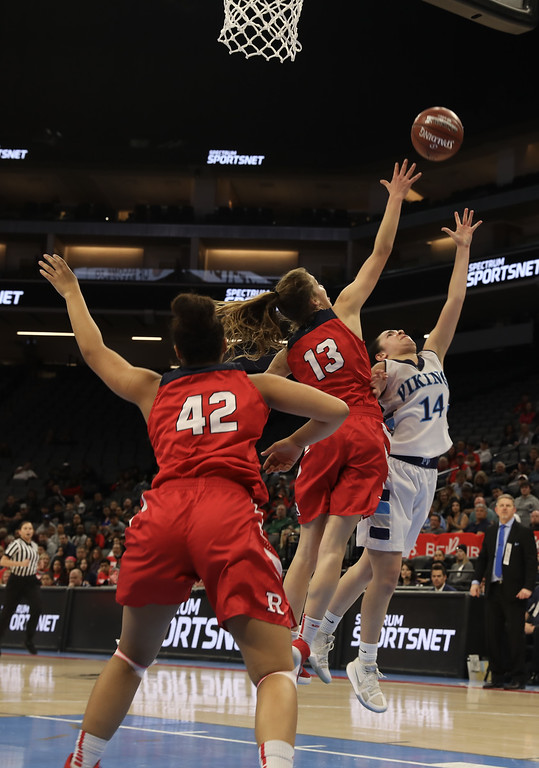 . Pleasant Valley High\'s Makenna Joyce (14) goes up for a shot against Redondo Union High\'s Ashlynn Autrey (42) and Calli Stoked (13) during the state championship game at Golden 1 Center, March 24, 2018, in Sacramento, California. (Carin Dorghalli -- Enterprise-Record)