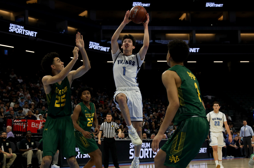 . Pleasant Valley High\'s Peyton Schneringer (1) goes up for a shot against Notre Dame High\'s Andrew Gosserand (25) and Anton Mozga (1) during the state championship game at Golden 1 Center, March 24, 2018, in Sacramento, California. (Carin Dorghalli -- Enterprise-Record)