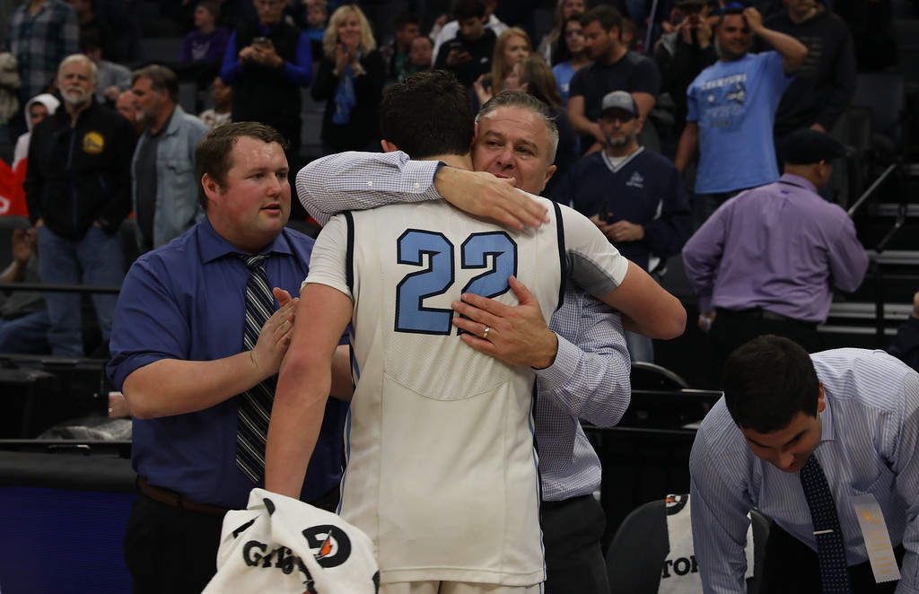 . Damon Whittaker, assistant coach, hugs Kevin Kremer after the boys win the state championship titles at Golden 1 Center, March 24, 2018, in Sacramento, California. (Carin Dorghalli -- Enterprise-Record)