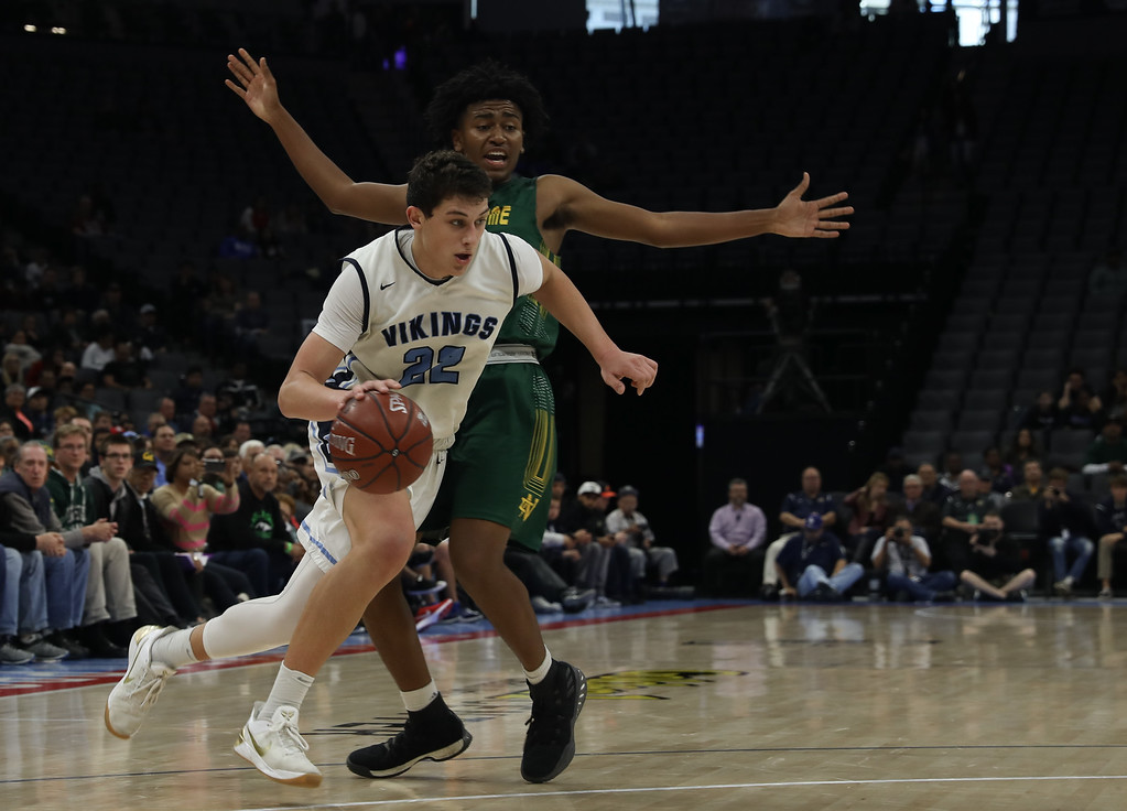 . Pleasant Valley High\'s Kevin Kremer (22) gets past the defender, Notre Dame High\'s Anthony Holland (23) duirng the state championship game at Golden 1 Center, March 24, 2018, in Sacramento, California. (Carin Dorghalli -- Enterprise-Record)