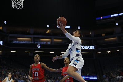 Pleasant Valley High's Sirena Tuitele finishes a layup against Redondo Union High's Dylan Horton (10) and Jasmine Davis (23) as the Vikings played for a state title Saturday at Golden One Center in Sacramento. Carin Dorghalli — Enterprise-Record
