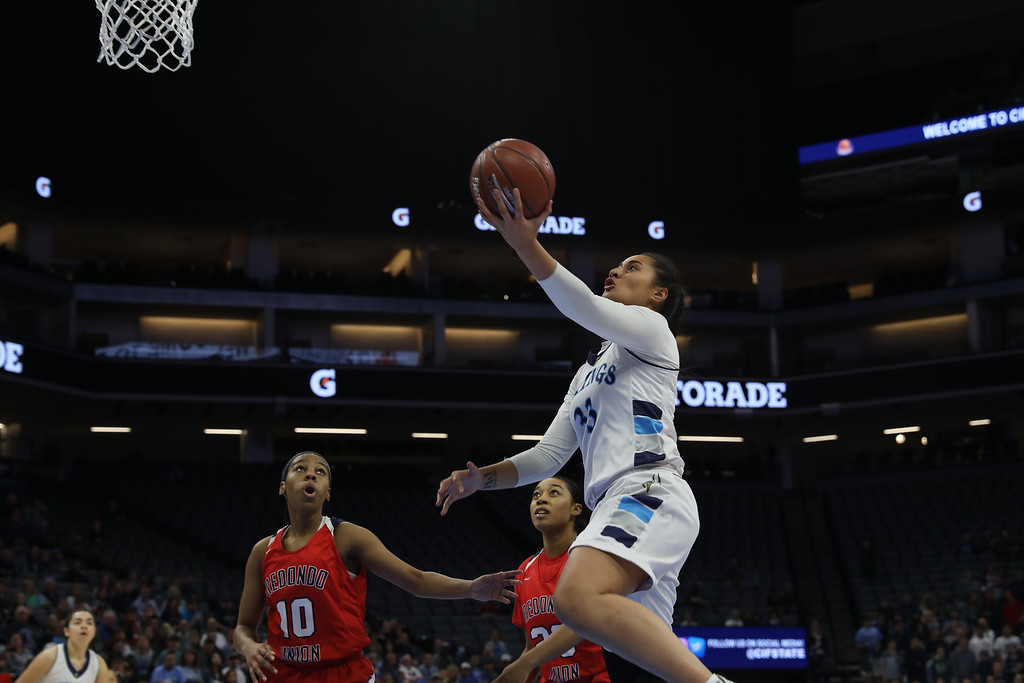 . Pleasant Valley High\'s Sirena Tuitele (33) goes up for a shot against Redondo Union High\'s Dylan Horton (10) and Jasmine Davis (23) during the state championship game at Golden 1 Center, March 24, 2018, in Sacramento, California. (Carin Dorghalli -- Enterprise-Record)