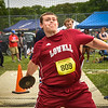 Ronan Dunn, senior discus thrower from Lowell, winds up during the 2nd flight for a powerful throw during Monday's state track meet at Andover High School.  Photo:  SUN/Scot Langdon