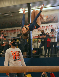 Dodgeville/Mineral Point/Iowa-Grant freshman Brooklyn Murphy performs a back tuck on balance beam at the WIAA Division 2 state meet on Saturday in LaCrosse. Murphy scored an 8.8 to finish 10th. Photo by Jason McMahon