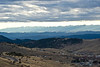 Here is a view of the Sangre de Cristo Mountains with part of Cripple Creek visible in the bottom right corner.  I liked how the clouds appear to be another mountain range.  I was at about 10,000 feet above sea level when I took this image.