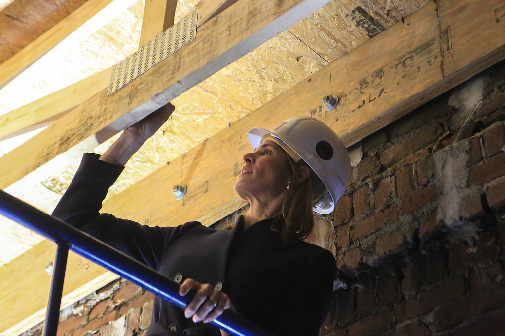 . House Rep Lori Trahan signs her name on the wooden truss where other dignataires had signed it at the start of the work on the site. SENTINEL&ENTERPRISE/Scott LaPrade