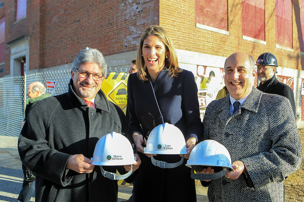 . House Rep Lori Trahan and Mayor Stephen DiNatale  and FSU President Richard Lapidus with there personalized hardhats before entering the BF Brown School building SENTINEL&ENTERPRISE/Scott LaPrade