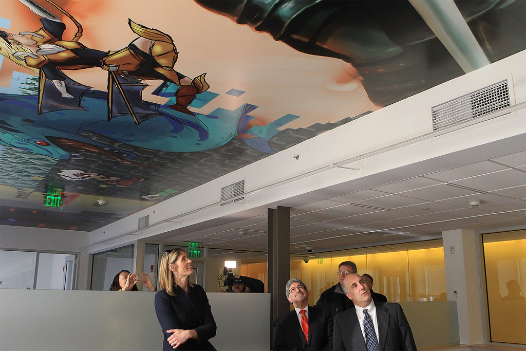 . Mayor Stephen DiNatale walks with House Rep Lori Trahan with Fitchburg State University President Richard Lapidus look over the painted ceiling in the Idea Center\'s 2nd floor done by students SENTINEL&ENTERPRISE/Scott LaPrade SENTINEL&ENTERPRISE/Scott LaPrade