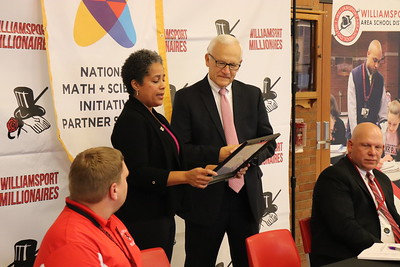 NMSI Program Manager Muriel presents Sen. Yaw with a certificate of recognition for his work in helping WAHS secure funding for the program.