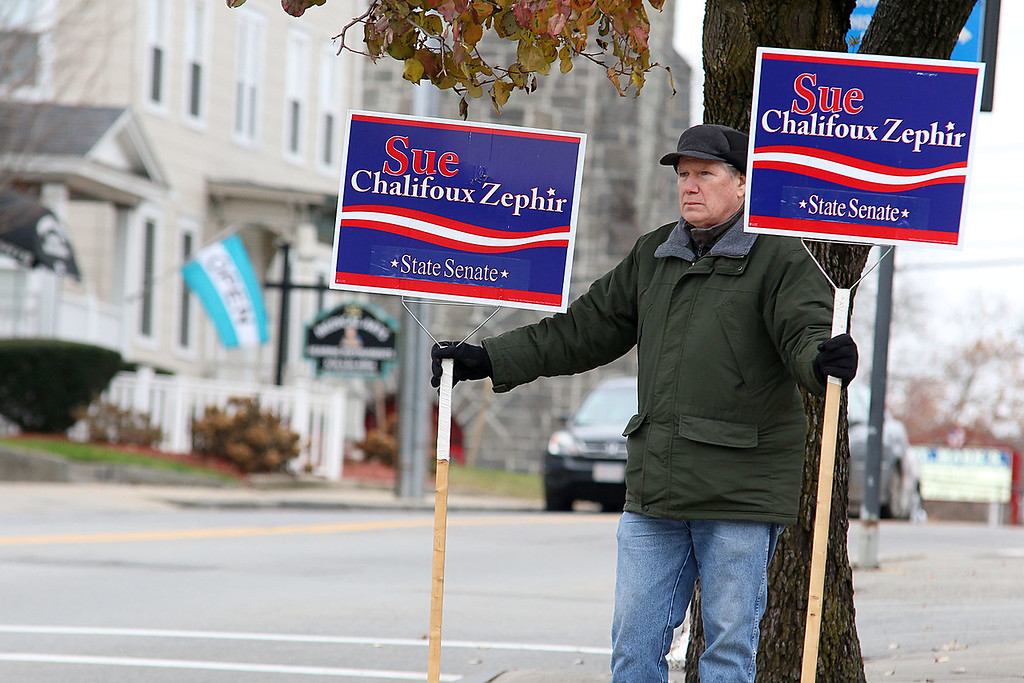 . Don Ciprotti hold some signs for Sue Chaligoux Zaphir at the polls at Leominster City Hall on Tuesday December 5, 2017 during the Worcester Middlesex District State Senate race. SENTINEL & ENTERPRISE/JOHN LOVE
