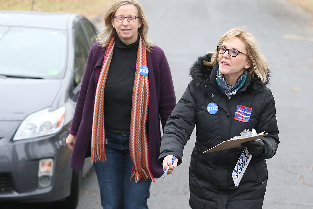 . Candidate Sue Chalifoux Zephir, on right, and volunteer Andrea Freeman go door to door on Swan Street in Fitchburg on Tuesday December 5, 2017 during the Worcester Middlesex District State Senate race. SENTINEL & ENTERPRISE/JOHN LOVE