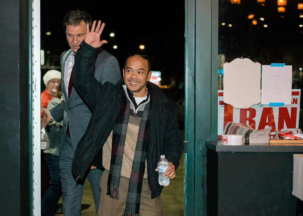 . Dean Tran, flanked by Worcester County Sheriff Lew Evangelidis, arrives at River Styx Brewing on Tuesday, December 5, 2017 after winning the special election. The special election was to fill the Worcester-Middlesex state Senate seat vacated by Jennifer Flanagan. SENTINEL & ENTERPRISE / Ashley Green