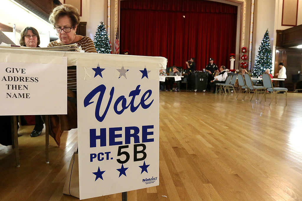 . Election worker Irene Greco waits for voters at precinct 5B at the polls in Leominster City Hall on Tuesday December 5, 2017 for the Worcester Middlesex District State Senate race. SENTINEL & ENTERPRISE/JOHN LOVE