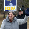 Candidate Claire Freda waves to voters the polls at Memorial Middle School in Fitchburg on Tuesday December 5, 2017 during the Worcester Middlesex District State Senate race as she hangs out with supporter John DeCicco. SENTINEL & ENTERPRISE/JOHN LOVE
