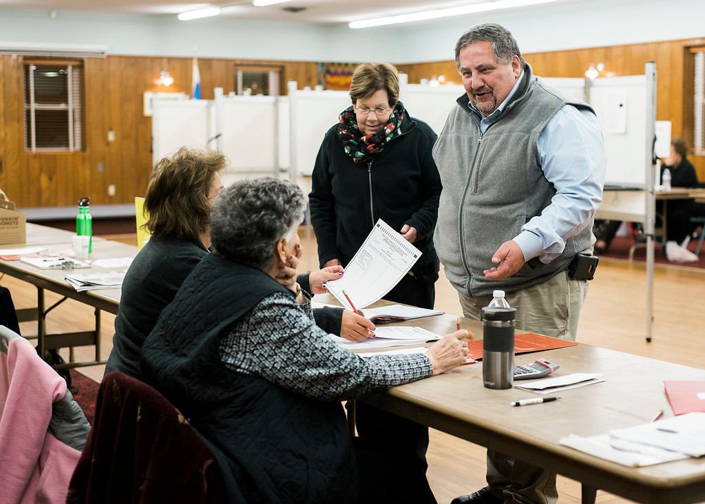. Former city councilor Angelo Bisol and wife Donna check-in at Saima Park during the general special election for the Worcester-Middlesex state Senate seat vacated by Jennifer Flanagan on Tuesday, December 5, 2017. SENTINEL & ENTERPRISE / Ashley Green