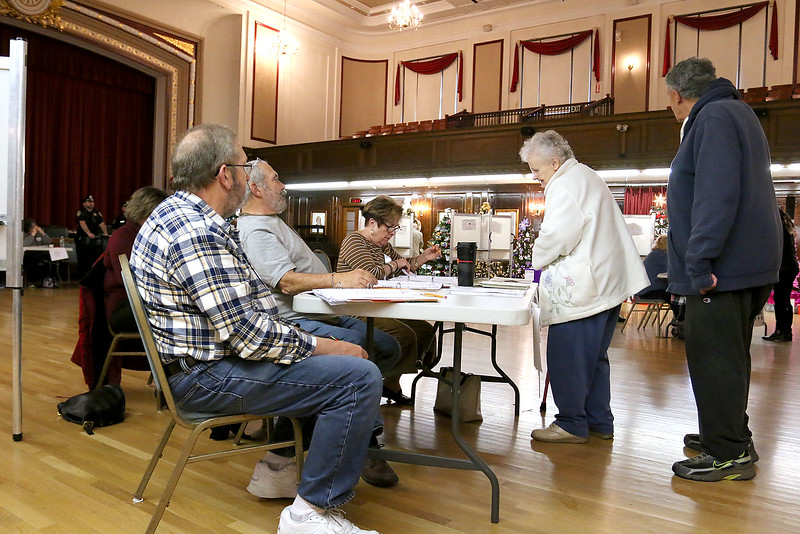 Voters check-in at the polls in Leominster City Hall on Tuesday December 5, 2017 for the Worcester Middlesex District State Senate race. SENTINEL & ENTERPRISE/JOHN LOVE