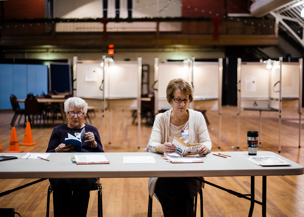 . Poll workers Pauline Sala and Frances Zakrzewski spend their downtime reading during the general special election for the Worcester-Middlesex state Senate seat vacated by Jennifer Flanagan on Tuesday, December 5, 2017. SENTINEL & ENTERPRISE / Ashley Green