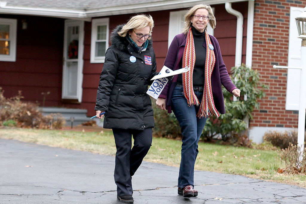 . Candidate Sue Chalifoux Zephir, on left, and volunteer Andrea Freeman go door to door on Swan Street in Fitchburg on Tuesday December 5, 2017 during the Worcester Middlesex District State Senate race. SENTINEL & ENTERPRISE/JOHN LOVE