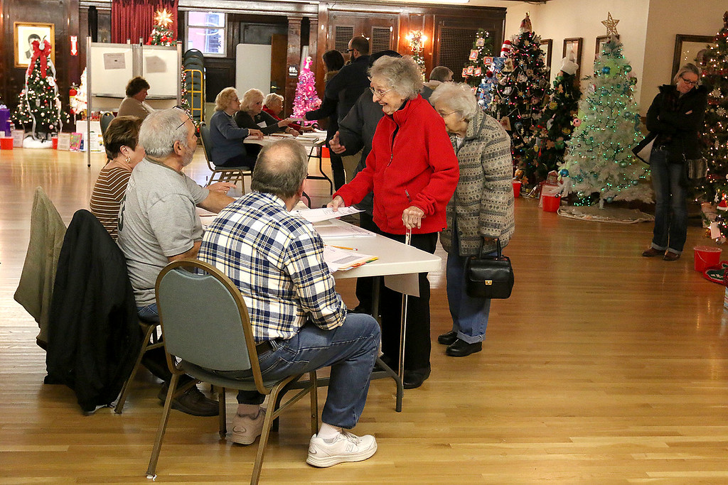 . Voters check-in  at the polls in Leominster City Hall on Tuesday December 5, 2017 for the Worcester Middlesex District State Senate race. SENTINEL & ENTERPRISE/JOHN LOVE