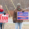 Kerry Tran the wife of candidate Dean Tran and George Sanders a Sue Chalifoux Zephir supporter hang out with signs at the polls at the St. Bernard's Activity Center in Fitchburg on Tuesday December 5, 2017 during the Worcester Middlesex District State Senate race. SENTINEL & ENTERPRISE/JOHN LOVE