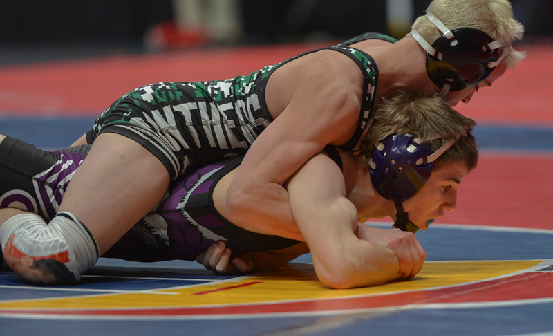 . Kitchen struggles to break free from Brady Hankin�s tight grasp during his second-round match at the 2019 CHSAA 3A State Wrestling Championships at the Pepsi Center.