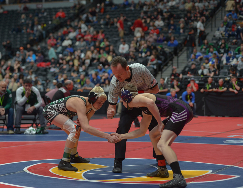 . Freshman Brady Hankin, left and sophomore Elijah Kitchen shake hands before their second-round bout of the 2019 CHSAA 3A State Wrestling Championships over the weekend at the Pepsi Center.