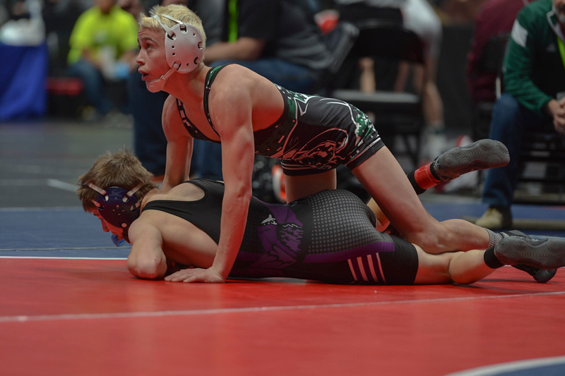 Brady Hankin of Woodland Park High School looks to the referee for a decision after it appeared that he had pinned Elijah Kitchen.