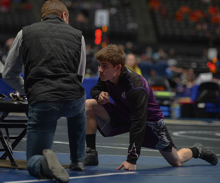 Sophomore Elijah Kitchen gets some words of encouragement from his coach before taking the mat in the second round of the 2019 CHSAA 3A State Wrestling Championships at the Pepsi Center over the weekend.
