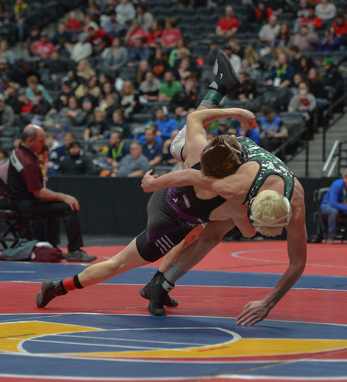 . Elijah Kitchen returns the favor to Brady Hankin of Woodland Park High School with a powerful takedown.