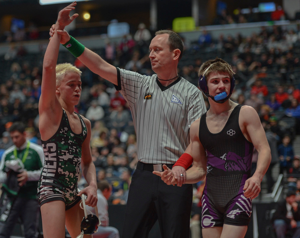 . A referee crowns Brady Hankin the victor against Estes Park High School sophomore Elijah Kitchen at the Pepsi Center over the weekend.