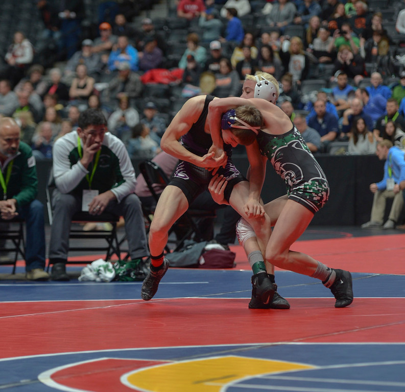 . Elijah Kitchen fights a takedown attempt by Brady Hankin.