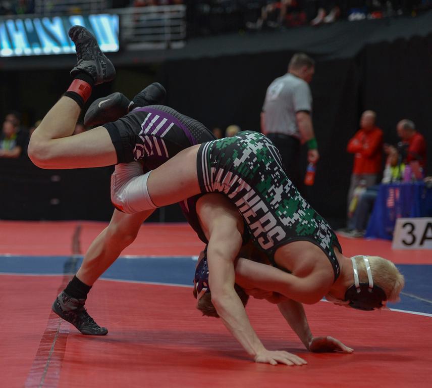 . Kitchen bucks and kicks to get freshman Brady Hankin off his back.